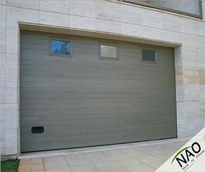 Porte de garage secionnelle sur mesure for Portail de garage sectionnel sur mesure