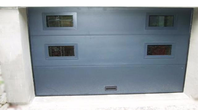 Devis porte garage sectionnelle porte garage panneaux lisses for Garage l eglantier lisses