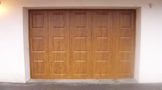 Nao fermetures porte de garage sectionnelle sur mesure for Porte de garage automatique sur mesure