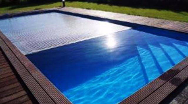 volet de piscine immerg volets immerg s. Black Bedroom Furniture Sets. Home Design Ideas