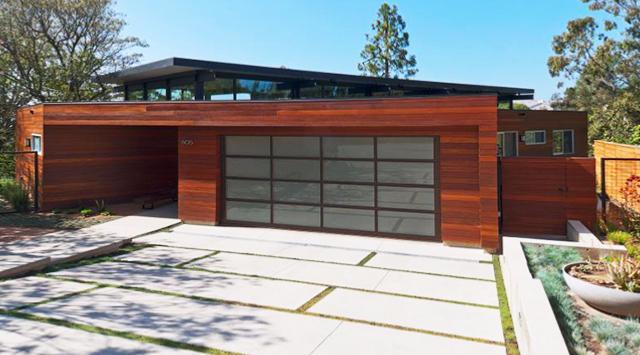 Porte de garage sectionnelle design sur mesure for Porte de garage automatique sur mesure