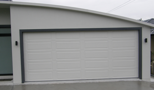 Porte de garage nao devis prix porte garage sur mesure for Porte sectionnelle garage 3m