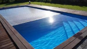 Volet de piscine immerg volets piscine for Volet polycarbonate piscine